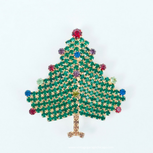 vintage Christmas Jewelry. 1970s Rhinestone Christmas tree brooch by Hobe at the Chicago Vintage Clothing and Jewelry show event. Edgewater, February.