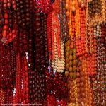 Chicago vintage clothing and jewelry show. Beads and necklaces of all eras shapes and sizes.