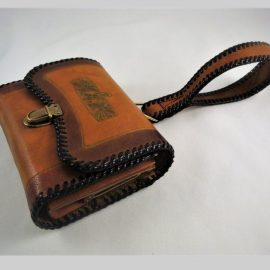 Arts & Crafts tooled leather wallets at the Chicago Vintage Clothing & Jewelry show