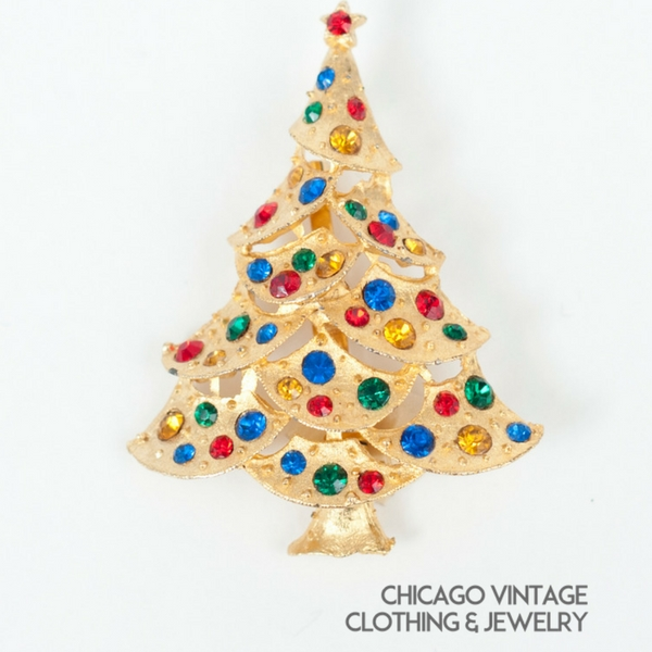 Vintage Christmas tree pin multiple stones green red blue amber pin.