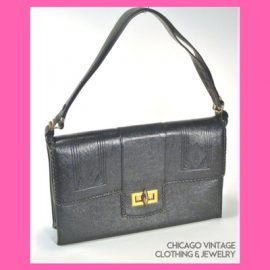 Hand Tooled leather bags from Edwardia at the Chicago Vintage Clothing and Jewelry Show