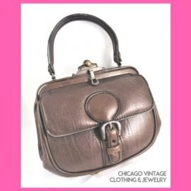 400 Hand Tooled leather bags from Edwardia at the Chicago Vintage Clothing and jewelry show