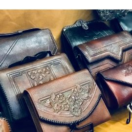 Edwardia deals in hand tooled amazing Arts & Crafts handbags 1950's sell fast too! Edwardia at the Chicago Vintage clothing and Jewelry show.