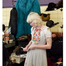 Karyn of Dethrose Vintage writing up sales at the Chicago Vintage clothing and Jewelry show.